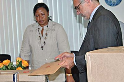 Mr Luis Moreno-Ocampo and Prosecutor Fatou Bensouda, check through list of Kenyan suspects at the ICC headquarters (file photo).