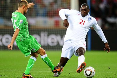 Algeria's Karim Ziani, left, and England's Emile Heskey battle for the ball.