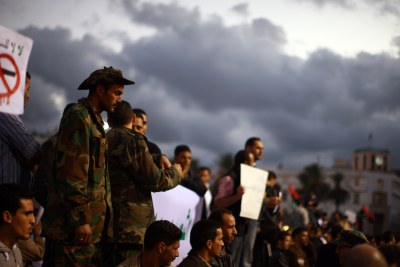 A crowd of demonstrators protest the ongoing use of weapons by rebel militias inside of Tripoli (file photo).