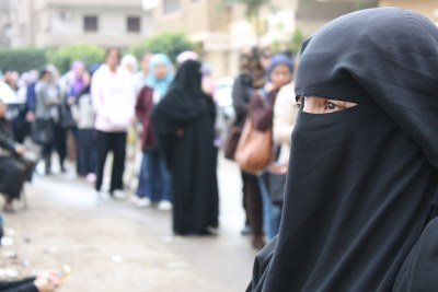Hayam Yousef, a mother of three, waits in line for her turn to vote in Egypt's first elections (file photo).