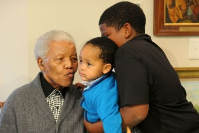 Madiba kisses his great-grandson