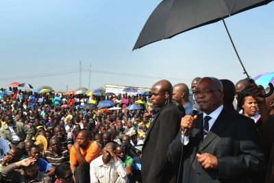 President Jacob Zuma is seen addressing striking Marikana miners at Lonmin's platinum mine.