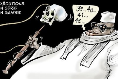 A cartoon of President Yahya Jammeh holding a human skull.