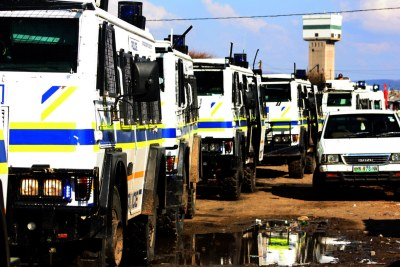 Armoured police patrol near Lonmin's Marikana mine (file photo).