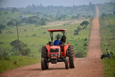 A tractor driving through farmlands.