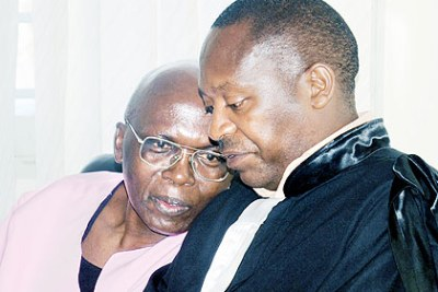 Genocide suspect Leon Mugesera (left) with his lawyer.