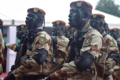 Members of Cote d'Ivoire's armed forces march during the country's Independence Day celebrations on Aug. 7.