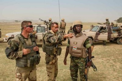 African soldiers along with French troops (file photo).