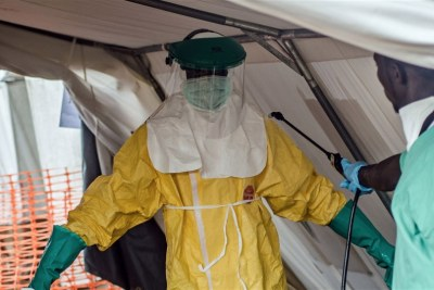An employee of Médecins Sans Frontières (MSF) prepares to treat Ebola victims in Sierra Leone.