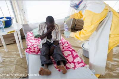 An Ebola patient receives treatment.