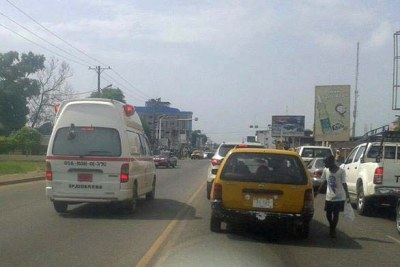 Ambulances ferry suspected Ebola patients in Monrovia.