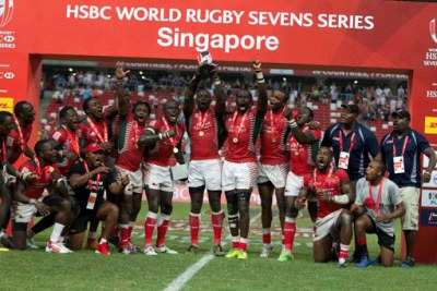Kenya Sevens rugby team players celebrate with the Main trophy after beating Fiji 30-7 in the final of the Singapore Sevens tournament (file photo).