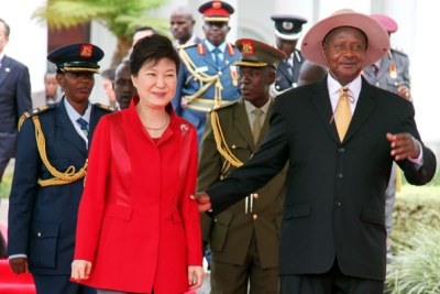 President Museveni (L) welcomes his South Korean counterpart Park Geun-Hye to State House Entebbe on last weekend.