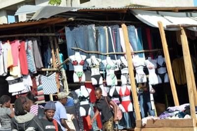 Second hand 'Mitumba' clothes on display at an open stall at a Kenyan market.
