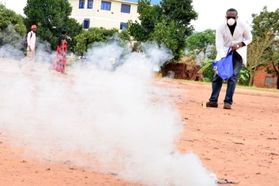Samuel Mugarura demonstrates the effectiveness of one of his tear gas canisters.