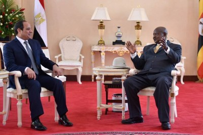 Sisi (left) and Museveni (right) held talks in Entebbe, Uganda