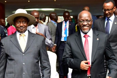 Tanzanian president John Pombe Magufuli (L) and Ugandan president Yoweri Museveni in Arusha for the 17th Ordinary Summit of the EAC Heads of State.