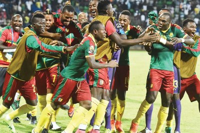 Camerounians celebrate their victory against Ghana