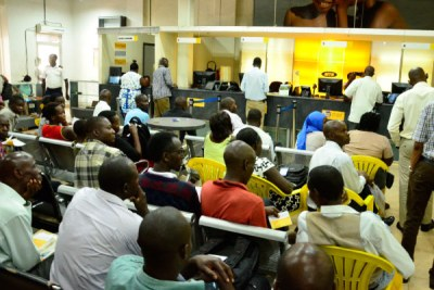 People wait to register their SIM cards at an MTN service centre in Kampala recently.