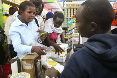 Residents of Maua, Meru County, pay for subsidised maize flour at Society Stores Supermarket on May 22, 2017.