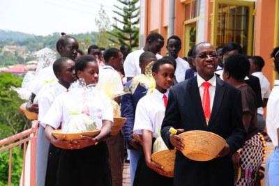 Principal and founder of St Lawrence Schools and Colleges Lawrence Mukiibi (right) during a thanksgiving service at one of the schools (file photo).