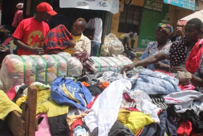 Second-hand clothes traders display their wares.