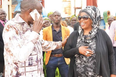 Amina Hersi, right, with Finance minister Matia Kasaija during a tour of a $120 million sugar factory in Atiak recently.