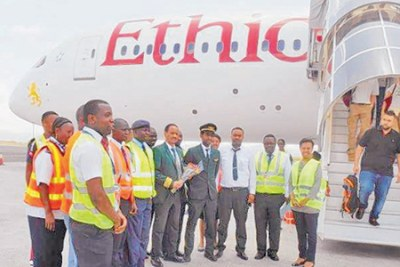 Kilimanjaro International Airport officials pose for a photo with Ethiopian airline staff after the aircraft landed at KIA.