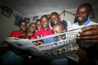 Family looking at the published KCPE examination candidates who performed well (file photo).