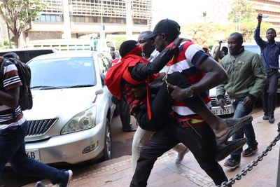 A Makerere University student and anti-age limit protester was manhandled by plain-clothes security officers at Parliament today.