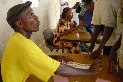 An election worker explains the ballot to a voter (file photo).