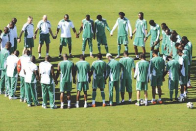 The Super Eagles at prayer.