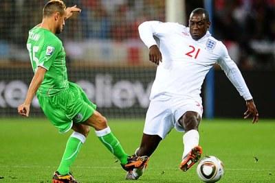 Algeria's Karim Ziani, left, and England's Emile Heskey battle for the ball.