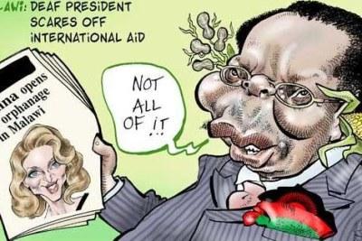 L'ancien président Bingu wa Mutharika du Malawi avec un portrait de la superstar Madonna.