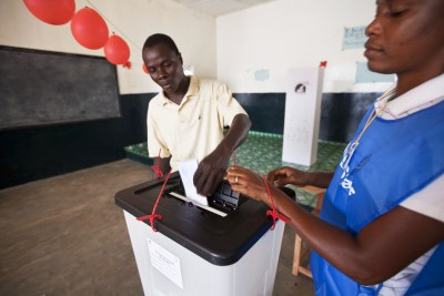 A voter casts his ballot in Liberia's constitutional referendum, in Monrovia. An amendment regarding the Liberian electoral system was among the items voted on.