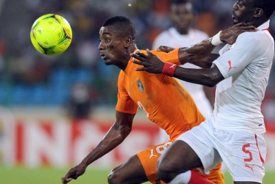 Saloman Kalou of Cote d'Ivoire and Mohamed Koffi of Burkina Faso.