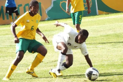 South Africa's Under-20 women's team, known as Basetsana, in yellow and green, battle Ghana.