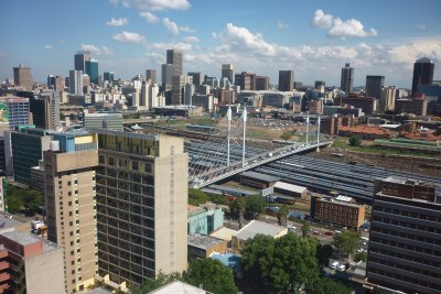 Looking out over Johannesburg from Braamfontein. Nelson Mandela bridge over the train station. CBD in the background
