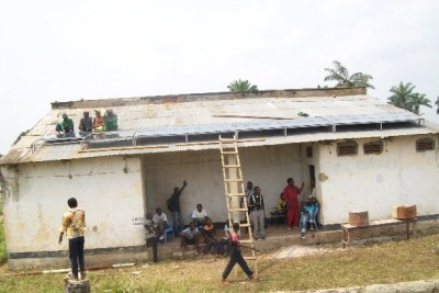 Local Villagers Installing Solar Panels