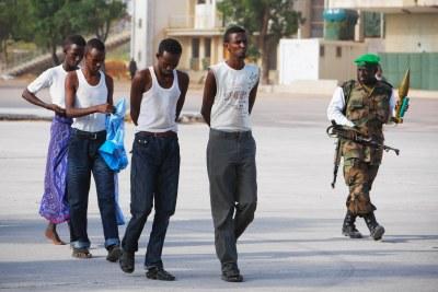 Four suspected members of Al Shabaab, the Islamic insurgent group, walk on the grounds of Mogadishu Stadium (file photo)