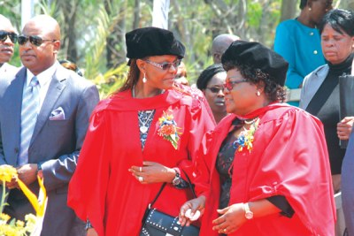 First Lady Grace Mugabe and Vice President Joyce Mujuru during her graduation ceremony.