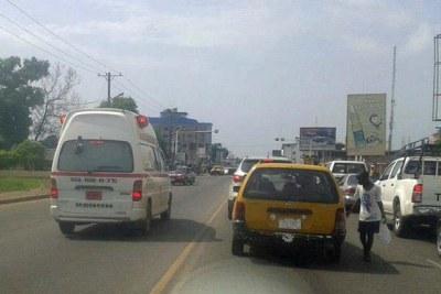 Ambulances ferry suspected Ebola patients in Monrovia.