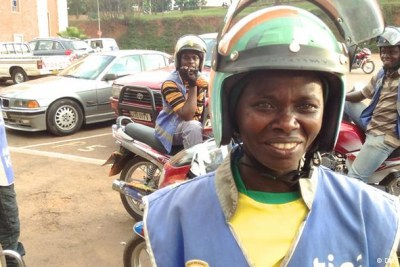 Motorcycle taxis are the main mode of transportation in Rwanda's capital, Kigali - Claudine Nyanamajambere is the only woman to drive a