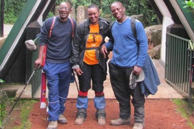 Zoe Wanjiru, centre, with clients at one of the entrances to Mount  Kilimanjaro.