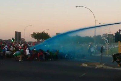 Police fired water cannons and stun grenades at protesters outside the University of the Western Cape in Cape Town.