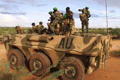 African Union soldiers atop a military vehicle on the outskirts of Burubow in the Gedo region of Somalia on February 14, 2014. Uganda is set to withdraw its troops from Somalia next year, ending a decade-long stay in the Horn of Africa country.