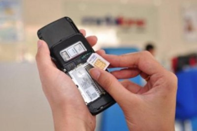 A person putting a SIM card in a mobile phone (file photo).