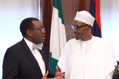Akinwumi Adesina, President of the African Development Bank (AfDB), with Nigerian President Muhammadu Buhari in Abuja on 26th September. The AfDB president visit to Nigeria will be his first official visit to the country since his appointment last year. Adesina will meet policy-makers, the private sector, and development partners to discuss the challenges facing Nigeria and highlight the AfDB's commitment to further strengthen its partnership with Nigeria