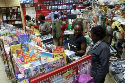 Parents buy textbooks for their children at Khimji Bookshop in Nyeri town (file photo).