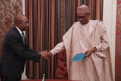 President Muhammadu Buhari  and the Central Bank Governor, Godwin Emefiele (file photo).